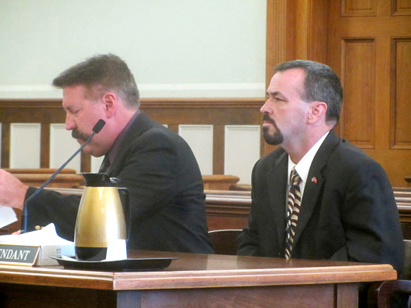 Lincoln County Sheriff's Deputy Kenneth L. Hatch III (right) sits with his attorney, Richard Elliott, of Boothbay Harbor, in a Knox County courtroom Tuesday, Aug. 23. (Stephen Betts photo/Bangor Daily News)