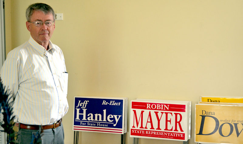 Lincoln County Republican Committee Chairman John O'Connell stands next to stacks of campaign signs in the committee's headquarters in Damariscotta on Wednesday, July 27. (Abigail Adams photo)
