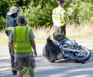 A 2016 Harley-Davidson motorcycle lays on its side on Pond Road in Newcastle after an accident the afternoon of Sunday, Aug. 7. The driver and passenger were transported to LincolnHealth's Miles Campus by ambulance. (Maia Zewert photo)