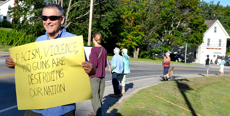 Mark Hamilton, of Walpole, participates in a vigil against racism at Veterans Memorial Park in Newcastle on Monday, Aug. 22. (Maia Zewert photo)