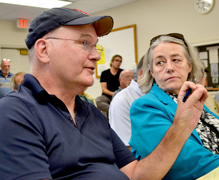 John Tibbetts addresses representatives from the Maine Department of Transportation about the Sherman Marsh Wetland Bank project as Martha Gaythwaite looks on during a meeting at the Newcastle fire station Wednesday, Aug. 17. (Maia Zewert photo)