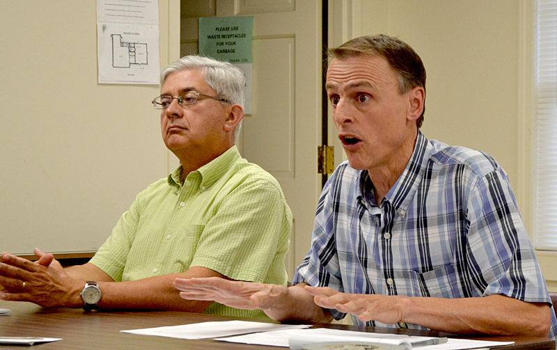 Maine Department of Transportation Project Manager Deane Van Dusen (right) answers a question as Charles Hebson, a manager of the DOT's surface water resources division, looks on during a meeting with Sherman Marsh property owners at the Newcastle fire station Wednesday, Aug. 17. (Maia Zewert photo)
