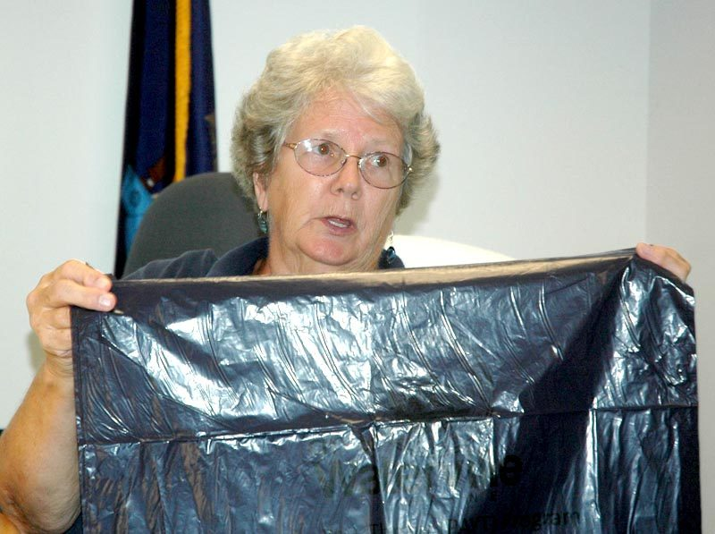 Waldoboro Selectman Katherine Winchenbach holds up one of the pay-as-you-throw bags used in Waterville during a public hearing on whether to send pay-as-you-throw to voters. (Alexander Violo photo)