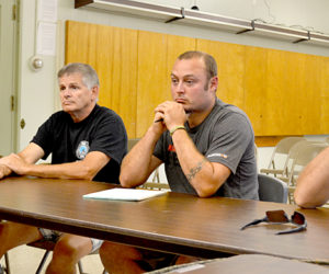 From left: Wiscasset Assistant Fire Chief Chris Cossette, Wiscasset Fire Department Safety Officer Tim Merry, Fire Chief T.J. Merry, and Assistant Fire Chief Nick Merry meet with the Wiscasset Board of Selectmen on Tuesday, Aug. 9 to discuss a potential resolution to a rift between firefighters and the selectmen and town administration. (Abigail Adams photo)
