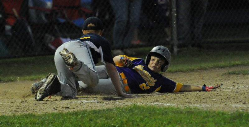 Bucksport's Ayden Maguire scores on a passed ball, as Medomak catcher Kyle Smith makes the catch. (Paula Roberts photo)