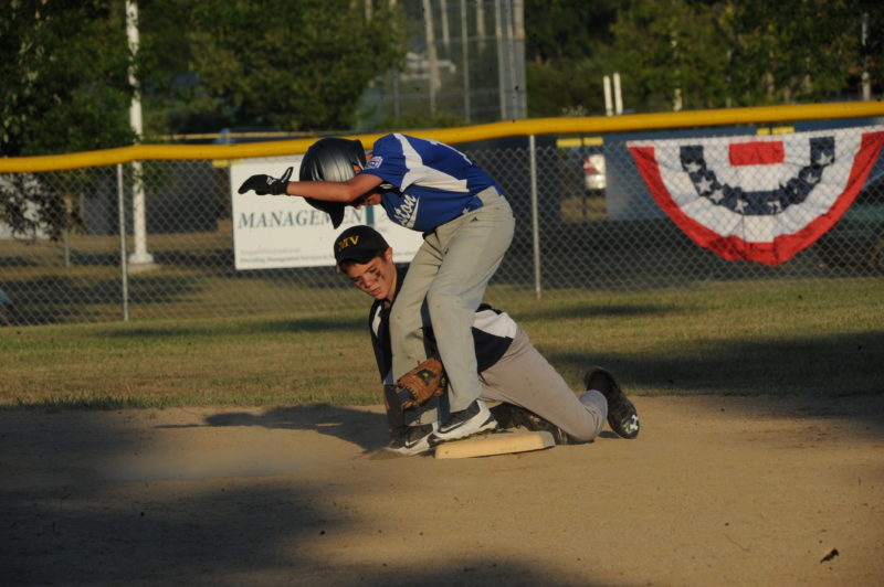 Isaac Staples applies the late tag to Lewiston's Bazton St. Hillaire.