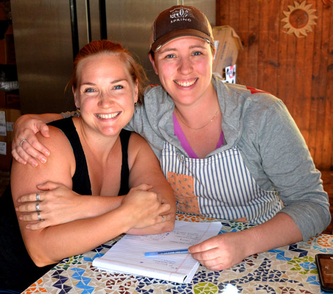 "Longtime friends Crystal Berg (left) and Andrea ""Annie"" Leck recently opened Barn Door Baking Company. The business operates out of the barn attached to Crissy's Breakfast and Coffee Bar, located at 212 Main St. in downtown Damariscotta. (Maia Zewert photo)"