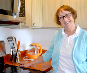 "Amy Kefauver stands in the kitchen of her Bristol Road rental apartment, where she will host the upcoming food-writers workshop featuring prominent New York editor Holly Hughes and cookbook author Kathy Gunst. Kefauver will prepare a communal lunch for workshop attendees, featuring a soup created from a recipe in Gunst's brand-new cookbook, ""Soup Swap."" (Christine LaPado-Breglia photo)"