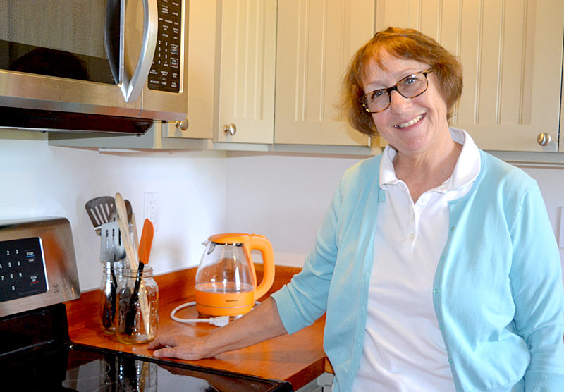 """Amy Kefauver stands in the kitchen of her Bristol Road rental apartment, where she will host the upcoming food-writers workshop featuring prominent New York editor Holly Hughes and cookbook author Kathy Gunst. Kefauver will prepare a communal lunch for workshop attendees, featuring a soup created from a recipe in Gunst's brand-new cookbook, """"Soup Swap."""" (Christine LaPado-Breglia photo)"""