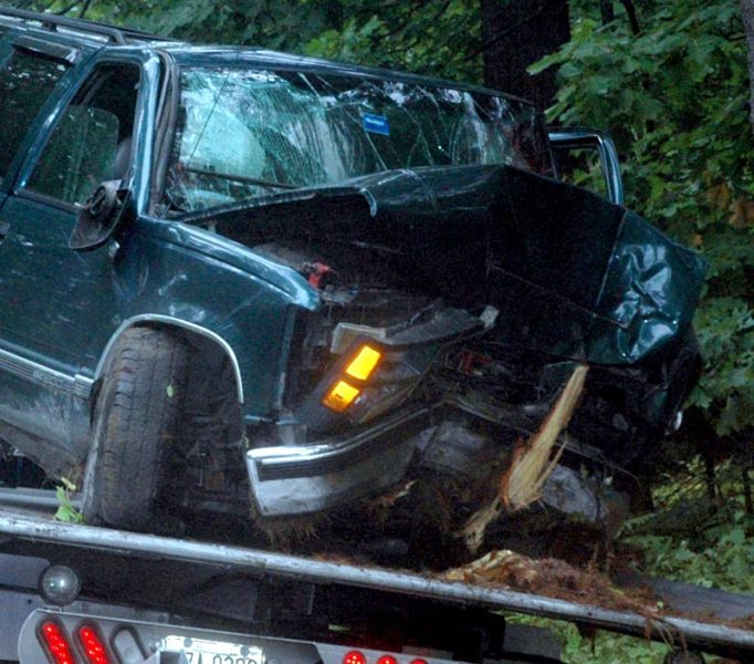 The driver of a green GMC SUV was taken by ambulance to LincolnHealth's Miles Campus in Damariscotta after the vehicle hit a tree on River Road in Newcastle the morning of Monday, Sept. 19. (Alexander Violo photo)