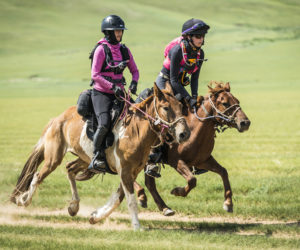 Newcastle native Julia Stewart (right) and another rider compete in the Mongol Derby. (Photo courtesy Richard Dunwoody/richarddunwoodyphotography.com)