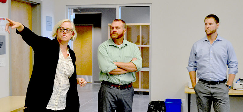 From left: Lincoln Academy Director of Innovation and Technology Maya Crosby points out a feature of a classroom in the Cable-Burns Applied Technology and Engineering Center to Daniel Burne and Alexander Wheelock, both of Becker Structural Engineers and members of the Maine chapter of the American Institute of Architects, Thursday, Sept. 15. (Maia Zewert photo)