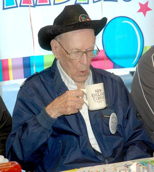 Woody Verge, of Waldoboro, enjoys a cup of coffee during his 100th birthday breakfast at Moody's Diner. (Alexander Violo photo)