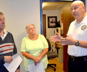From left: Wiscasset Selectmen Ben Rines and Judy Colby listen as Wiscasset Ambulance Service Director Toby Martin explains the department's needs during the selectmen's tour of the department Monday, Sept. 12. (Abigail Adams photo)