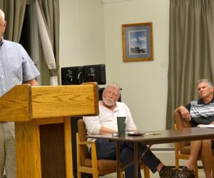 From left: Wiscasset resident Carl Amirault expresses concern about the town's rising mil rate as Wiscasset School Committee member Glen Craig and Tim Merry look on. (Abigail Adams photo)