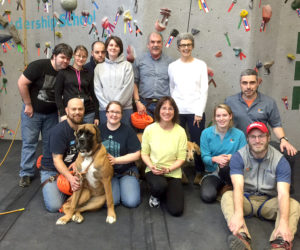 Embrace A Vet participants, with the assistance of Kieve-Wavus staf,f climb on Kieve's indoor climbing facility on the Nobleboro campus.