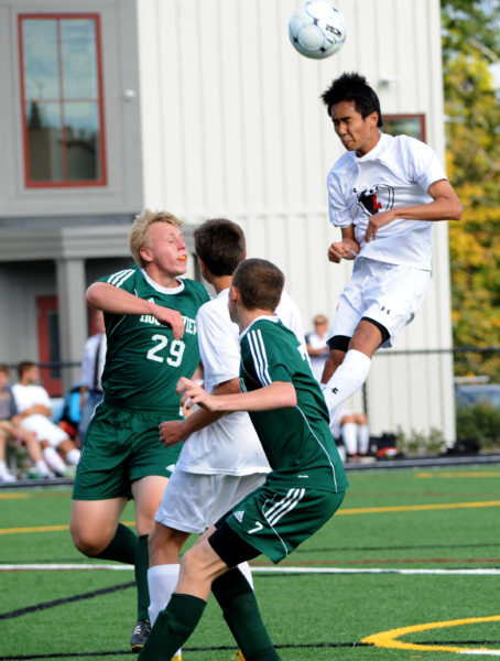 Min Choi leaps into the air to head the ball on net in the Eagles 1-0 win over Mt.View. (Paula Roberts photo)