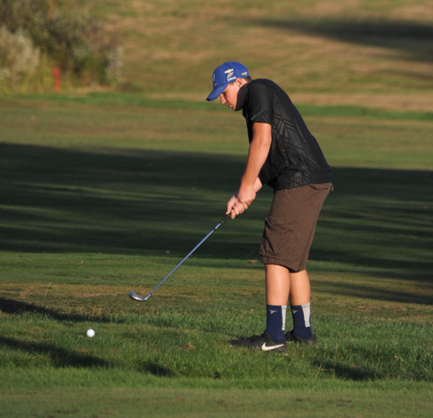 Liam Gilbert chips onto a green in Lincoln Academy's KVAC playoff win over Morse. (Paula Roberts photo)