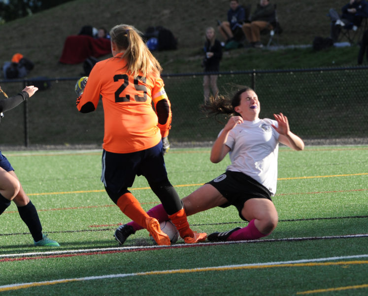 Medomak Valley goalkeeper Chelsea Ripley makes the stop on Lady Eagle Anna Hatch.