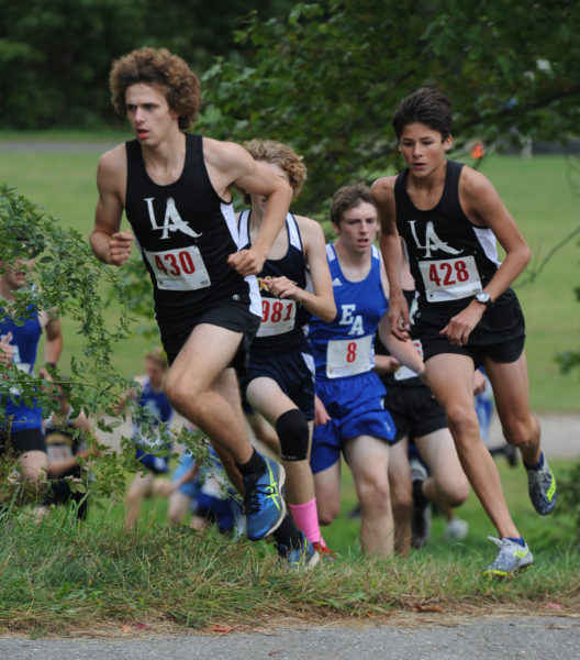 Noah Jordan and Jarrett Gulden compete in the Eagles Homecoming meet on Friday. (Paula Roberts photo)