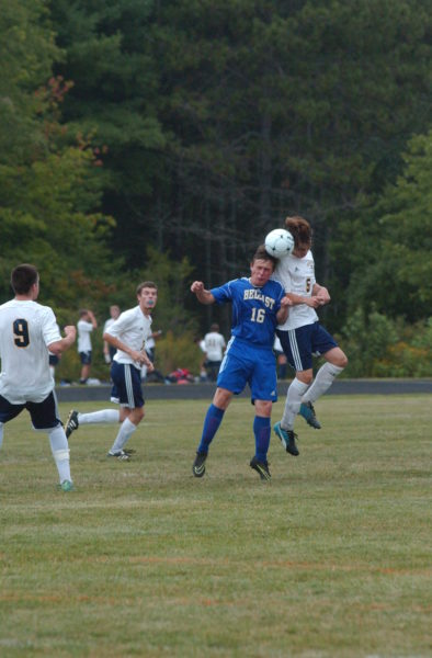 Isaac Eutsler heads the ball for the Panthers. (Carrie Reynolds photo)