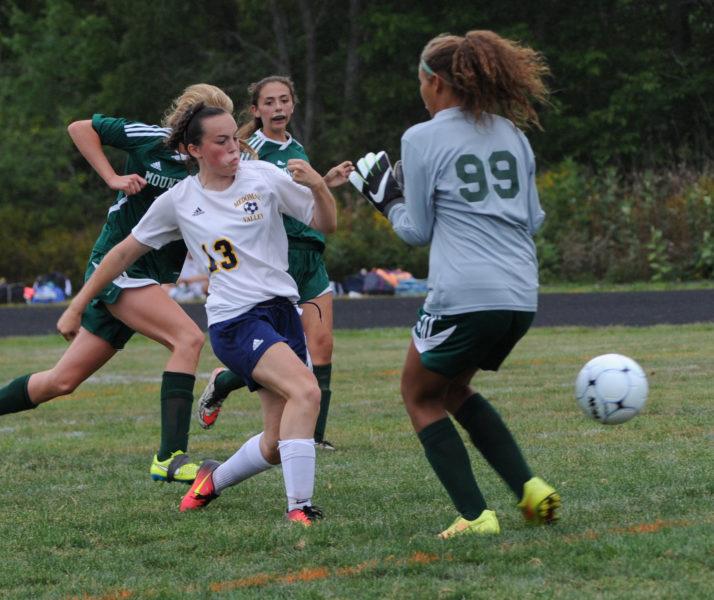 Hannah Prock puts the winning goal past Mt.View keeper Shala Davis with five minutes to play. (Paula Roberts photo)