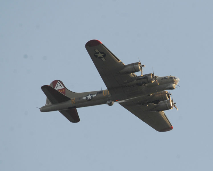 A World War II-era B-17 Flying Fortress bomber flies low over Wawenock Golf Course in Walpole on Thursday, Sept. 22. (Paula Roberts photo)
