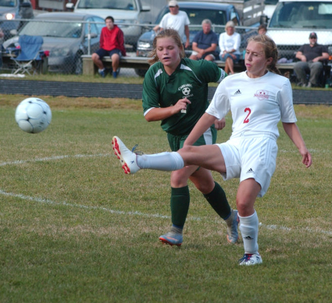 Lady Wolverine Stephanie Jones passes the ball up the field in Wiscasset's win over Carrabec. (Carrie Reynolds photo)