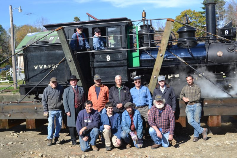 Wiscasset, Waterville & Farmington Railway Museum volunteers stand in front of Engine No. 9 on the museum's new turntable Saturday, Oct. 15. Front from left: Eric Shade, Ben Shade, James Patten,  and Bob Holmes. Middle: Zach Wyllie, Steve Zuppa, Mike Fox, Phil Goodwin, Randy Beach, John Robertson, and Jason Lamontagne. Back: J.B. Smith and Gordon Cook. (Abigail Adams photo)