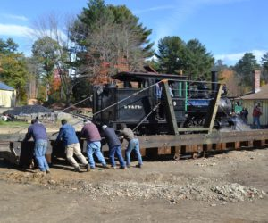 Wiscasset, Waterville & Farmington Railway Museum volunteers push Engine No. 9 on the museum's turntable Saturday, Oct. 15. (Abigail Adams photo)