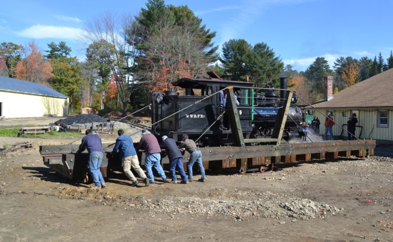 Wiscasset, Waterville & Farmington Railway Museum volunteers push Engine No. 9 on the museum's turntable Saturday, Oct. 15. (Abigail Adams photo)