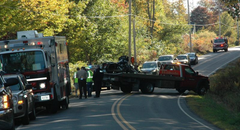 A tow truck prepares to haul away a motorcycle after an accident on Route 32 in Bremen the afternoon of Friday, Oct. 7. (Alexander Violo photo)