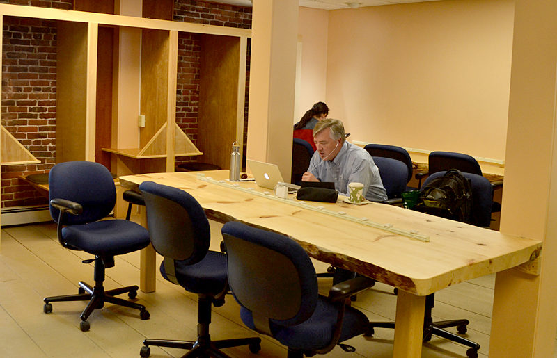 Buzz Maine, in downtown Damariscotta, has a large collaborative workspace in the center of the building, which allows members to work together on projects. Private work areas line the back of the room for those who wish to work quietly. (Maia Zewert photo)