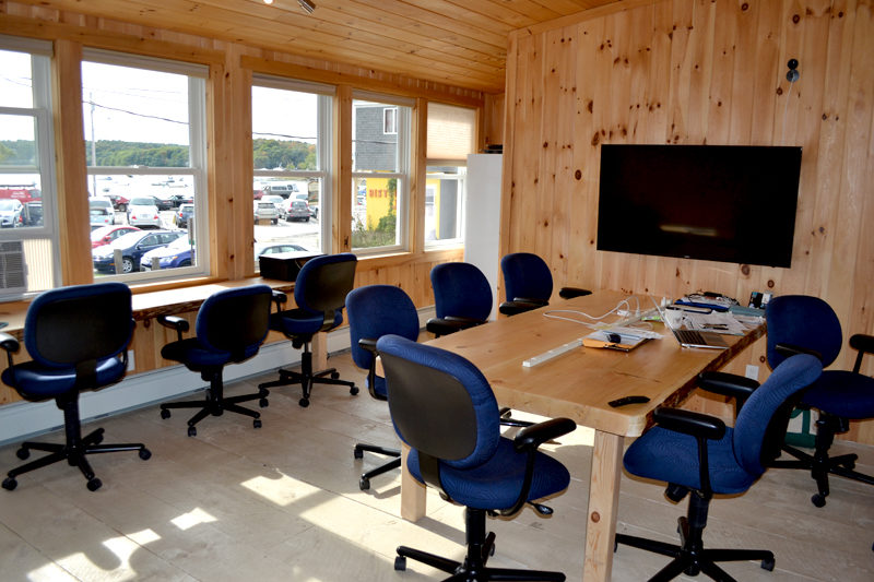 """Buzz Maine has a conference room available for members and the public to rent on an hourly basis. Co-owner Jennifer Van Horne said the business hopes to bring in speakers and workshops for """"Buzz talks."""" (Maia Zewert photo)"""