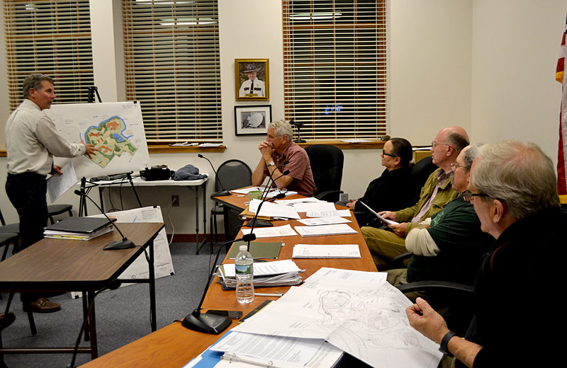 Peter Biegel, a landscape architect with Land Design Solutions, presents the plan for LincolnHealth's outpatient health center to the Damariscotta Planning Board and Town Planner Tony Dater on Monday, Oct. 3. LincolnHealth plans to build the 2 1/2-story building between between the hospital and Schooner Cove. (Maia Zewert photo)