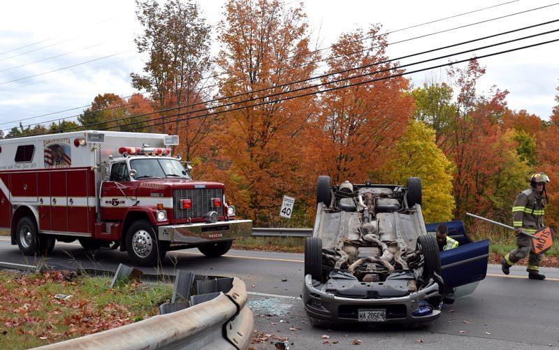 Damariscotta firefighters and police respond to the scene of a rollover at the intersection of Main Street and School Street in Damariscotta on Thursday, Oct. 13. (J.W. Oliver photo)