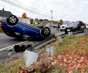 A Subaru rests on its roof after a single-vehicle accident at the intersection of Main Street and School Street in Damariscotta on Thursday, Oct. 13. (J.W. Oliver photo)