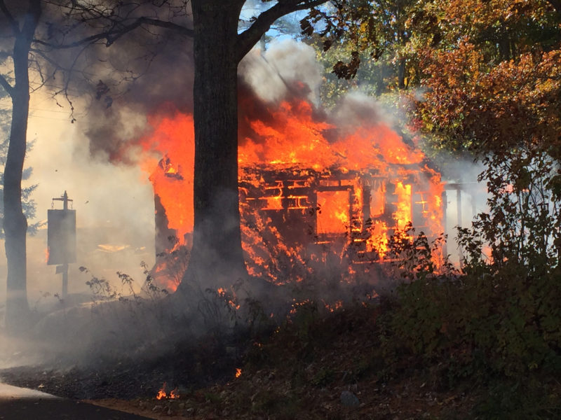 A structure burns on North Dyer Neck Road in Newcastle. (Maia Zewert photo)