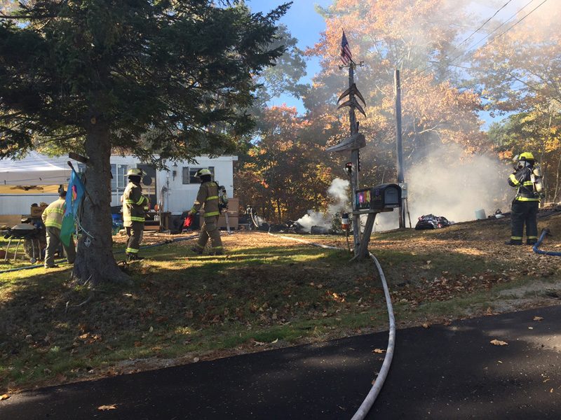 Firefighters work at the scene of a structure fire in Newcastle the afternoon of Wednesday, Oct. 19.