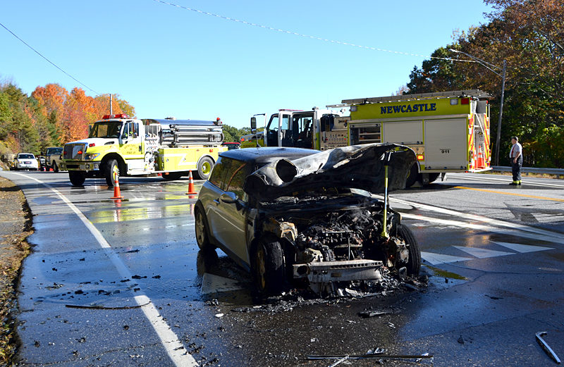 A two-car collision resulted in a car fire near the Route 1 southbound on-ramp in Newcastle the morning of Tuesday, Oct. 11. The occupants of the vehicle that burned, including a dog, were able to exit the vehicle safely and no injuries were reported, according to Lincoln County Sheriff's Office Sgt. Jason Nein. (Maia Zewert photo)