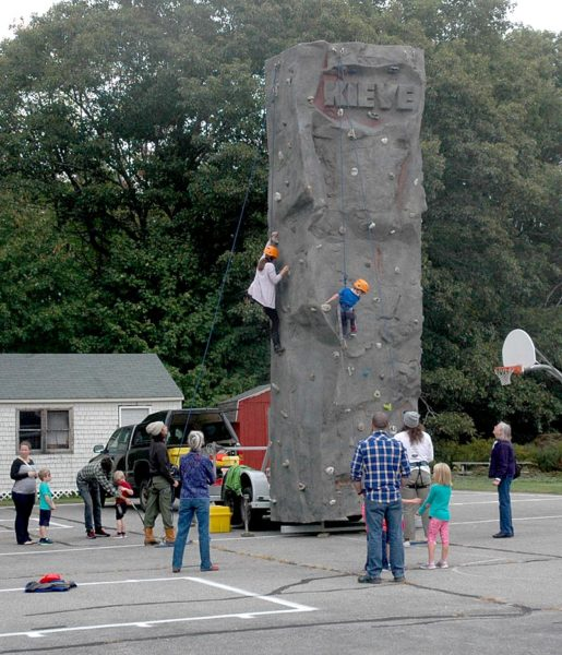 The Leadership School at Kieve-Wavus brought its climbing wall to AppleFest on Saturday, Oct. 1. (Alexander Violo photo)