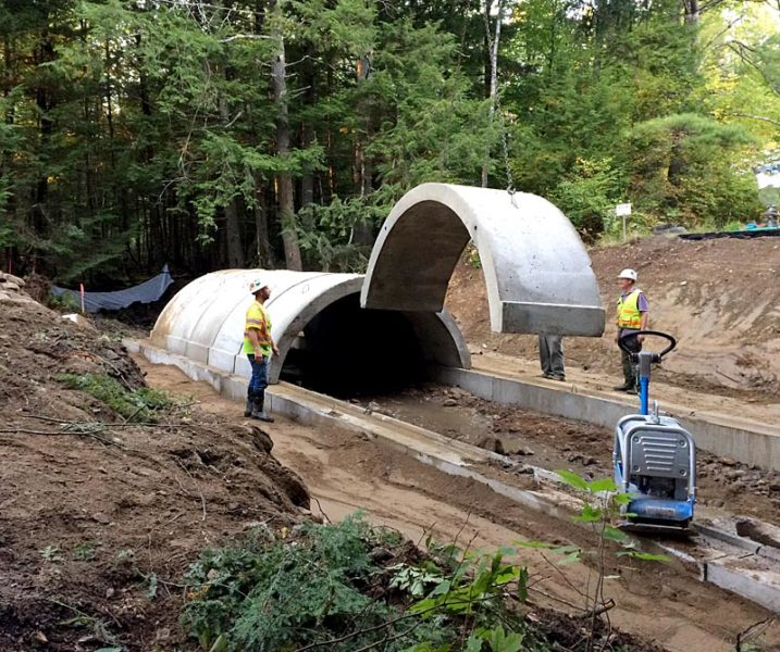 A crew from McGee Costruction installs the concrete arches of the new Vigue Road culvert in Whitefield on Tuesday, Sept. 27. (Photo courtesy Garrison Beck)