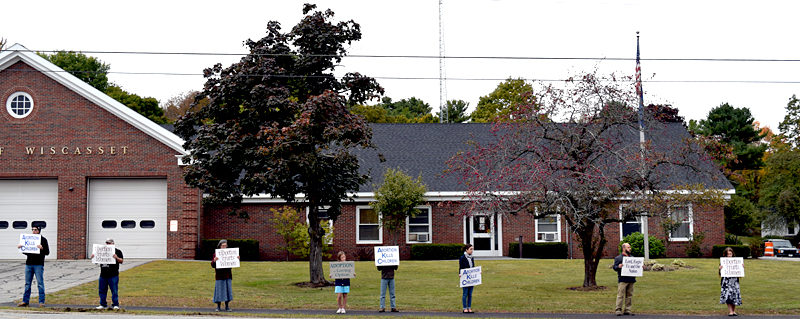 Life Chain participants hold signs on a sidewalk in front of the Wiscasset municipal building Sunday, Oct. 2. (J.W. Oliver photo)