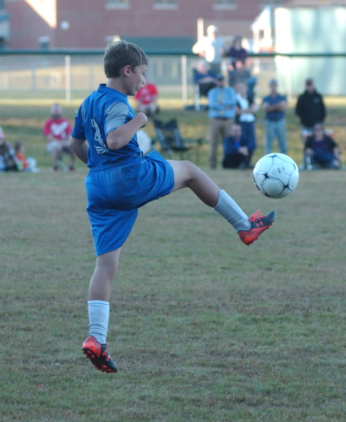 Gavin Kirkland boots the ball up the field for Jefferson. (Carrie Reynolds photo)