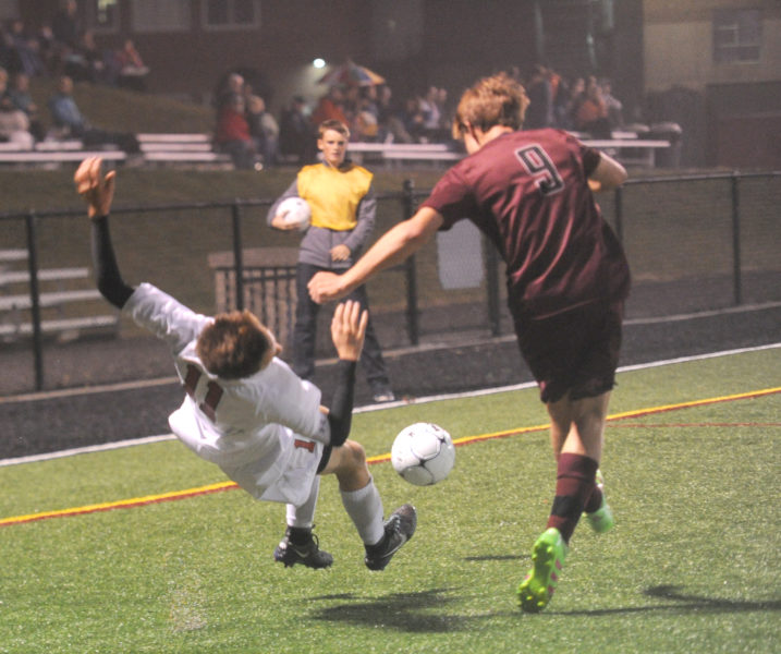 Nolen Michael has his feet kicked out from under him by Freeport's Shea Wagner.