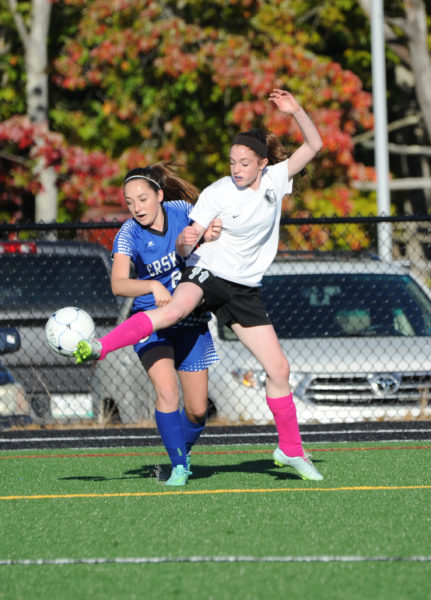 Madeline York wins the ball in a battle with Erskine Academy's Annemarie Allen. (Paula Roberts photo)