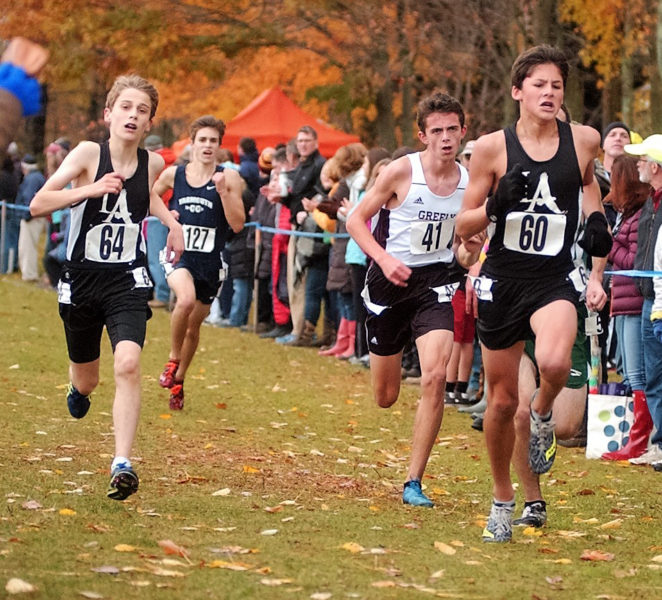 Lincoln Academy runners Benji Pugh and Jarrett Gulden run at the South B Regionals in the rain on Oct. 29.  (Carrie Reynolds photo)