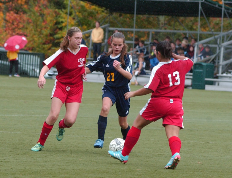 Mackenzie Emerson tries to split a pair of Camden defenders. (Carrie Reynolds photo)