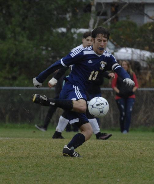 Jonathan Allard passes the ball up the field for Medomak Valley. (Paula Roberts photo)