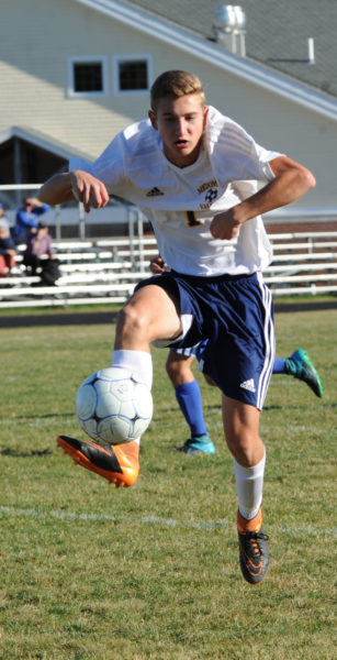 Joey Horovitz soars throught the air to trap the ball for the Panthers.  (Paula Roberts photo)
